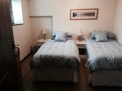Downstairs bedroom with 2 singles or super king